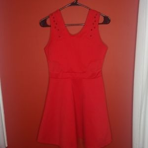 Red skater dress with spikes